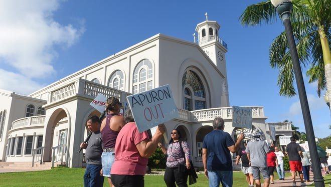 In this Jan. 29, 2017, file photo, members and supporters of the Laity Forward Movement and the Concerned Catholics of Guam hold a protest against Archbishop Anthony Apuron in front of the Dulce Nombre de Maria Cathedral-Basilica in Hagåtña.