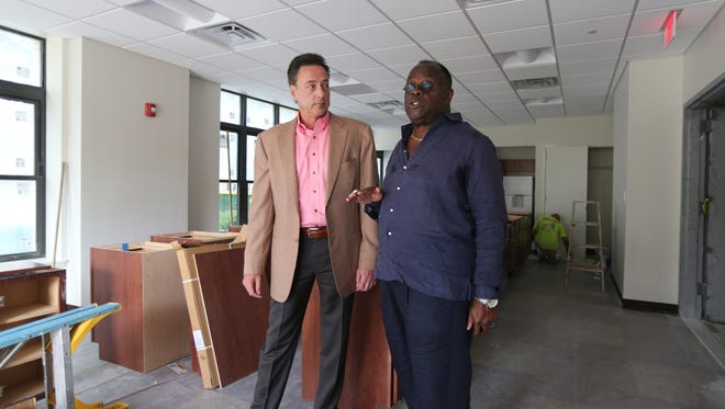 The Rev. W. Franklyn Richardson, right, pastor of the Grace Baptist Church in Mount Vernon, chats with developer Joel B. Mounty, president of Mountco Construction and Development Corp. in the nearly completed Grace Terrace senior apartments in Mount Vernon, Aug. 8, 2016.