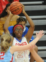 Cooper's Daniece Edwards (21) looks to pass the ball