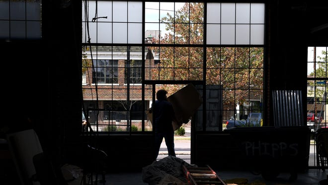 David Patterson of Phipps Construction works on renovating a space for future retail.