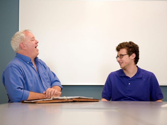 Comedians Harrison Brown, 19, right, and his father