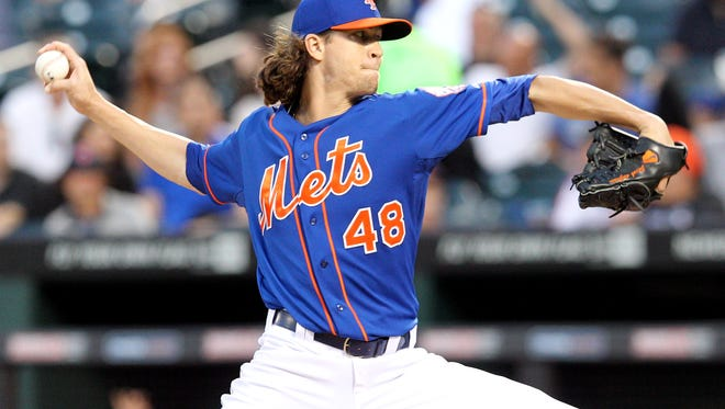 New York Mets starting pitcher Jacob deGrom pitches against the Philadelphia Phillies during the first inning of a game at Citi Field.