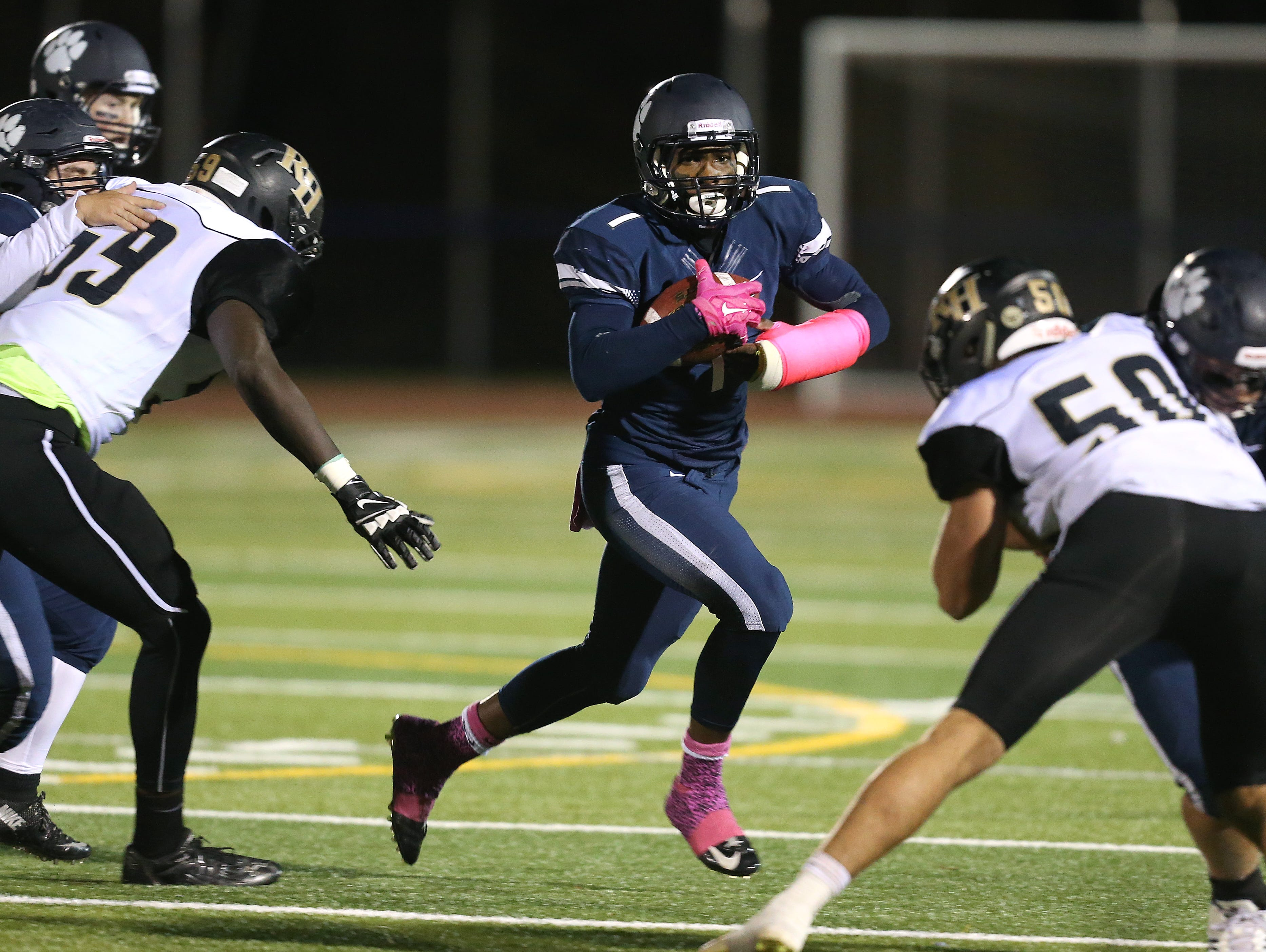 Pittsford's Josh Mack looks for a hole at the line of scrimmage against Rush-Henrietta.
