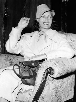 FILE - In this July 17, 1946, file photo, film actress Greta Garbo smiles on her arrival in Gothenburg, Sweden. The New York Times reported that the Swedish-born star's seven-room Manhattan co-op overlooking the East River is on the market for $5.95 million, with monthly maintenance of nearly $9,100.
