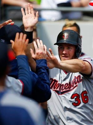 Minnesota Twins' Robbie Grossman (36) celebrates with teammates after scoring on a single by Joe Mauer during the third inning of a baseball game against the Chicago White Sox, Sunday, April 9, in Chicago.