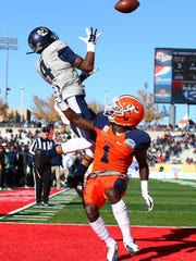 Dec 20, 2014; Albuquerque, NM, USA; Utah State Aggies wide receiver Hunter Sharp (4) attempts to catch a pass under pressure from UTEP Miners defensive back Adrian James (1) in the second quarter during the 2014 New Mexico Bowl at University Stadium. Mandatory Credit: Mark J. Rebilas-USA TODAY Sports
