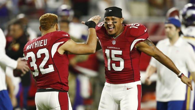 Arizona Cardinals Tyrann Mathieu and Michael Floyd (15) against the Minnesota Vikings in the first half on Dec. 10, 2015 in Glendale, Ariz.
