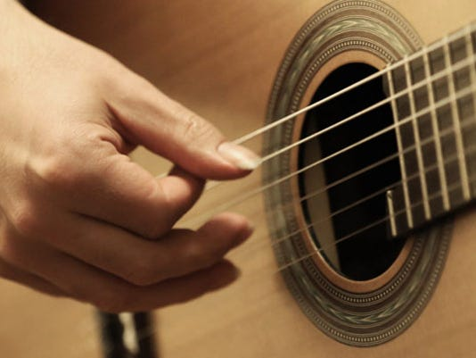 636213832529642727-top-guitar.jpg