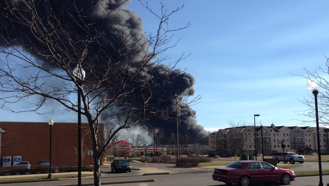 Smoke rises from a large fire in Lexington. Authorities say the large fire at the Blue Grass Stockyards complex has spread to other businesses.