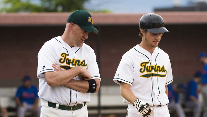 New Oxford's Scott Meckley, left, and Anthony Lippy, talk as Lippy walks to first during a South Penn League game against Mummasburg at New Oxford High School earlier this week.