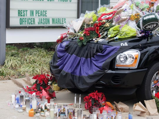 Memorial set up on a police cruiser for Ocean Gate Police officer Jason Marles outside the police station in Ocean Gate after Marles was killed in 2010.