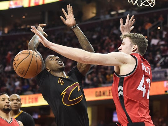 Apr 12, 2017; Cleveland, OH, USA; Cleveland Cavaliers guard Iman Shumpert (4) looses the ball against Toronto Raptors center Jakob Poeltl (42) during the second half at Quicken Loans Arena. The Raptors won 98-83. Mandatory Credit: Ken Blaze-USA TODAY Sports