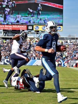 Titans quarterback Marcus Mariota (8) runs in for a touchdown in the first half at Nissan Stadium Sunday, Dec. 3, 2017 in Nashville, Tenn.
