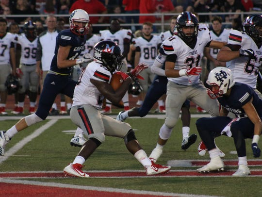 Many's AJ Carter runs for yardage against North DeSoto this fall.