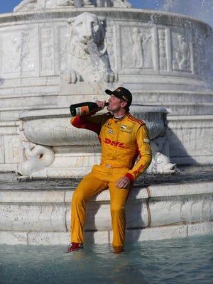 Ryan Hunter-Reay celebrates in Scott Fountain after winning the Detroit Grand Prix on Sunday on Belle Isle.
