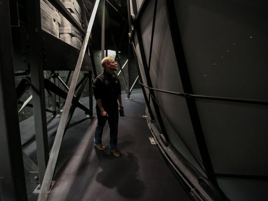 Justin Rule, Science Center of Iowa Chief IMAX Projectionist walks behind the dome screen on Sunday, Dec. 13, 2015, at the SCI.