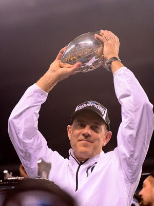 Michigan State Spartans head coach Mark Dantonio holds the championship trophy after defeating Ohio State Buckeyes 34-24 to win the 2013 Big 10 Championship game Dec. 7, 2013, at Lucas Oil Stadium.