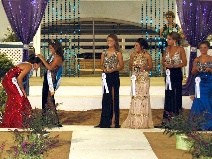 From left, Tiffany Huffman, 18, of Hebron is crowned Miss Boone County Fair 2014 by Miss Boone County Fair 2013 Paige Klee of Verona with first runner-up Gabrielle Brandt, 18, of Walton, second runner-up Jessica Evans, 20, of Walton, third runner-up Morgan Roberts, 17, of Union and Miss Congeniality Abigail Buechel, 17, of Burlington during the pageant held Tuesday, Aug. 5, 2014, in Burlington.