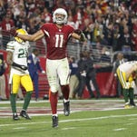 Cardinals wide receiver Larry Fitzgerald (11) celebrates after a 75-yard catch that set up the game-winning score against the Packers during the 2016 NFC Divisional Playoff Game at the University of Phoenix Stadium in Glendale on Jan. 16, 2016.