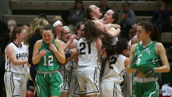 Irvington's Heather Hall (12) and Abby Conklin walk off the court as Susquehanna Valley celebrates their victory in the girls Class B championship game at Hudson Valley Community College in Troy March 17, 2018.