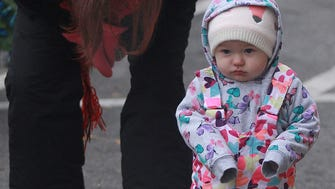 15-month-old Luna is all bundled up for the Christmas parade with mom Krissy Weber in Gallatin on Sat. Dec. 9, 2017.