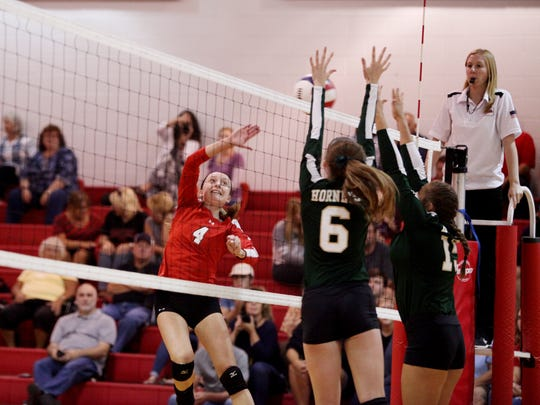 Riverheads' Emma Tomlinson attempts a spike during