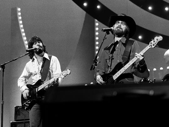 Jeff Cook, left, Randy Owen and Teddy Gentry of Alabama perform during the 15th annual CMA Awards show Oct. 12, 1981. The band is celebrating its 50th anniversary this year.