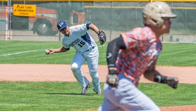 Piedra Vista's Logan Klunder makes a barehanded play at third base to get an out during a 4A state playoff game against Artesia on Thursday at St. Pius X High School in Albuquerque.