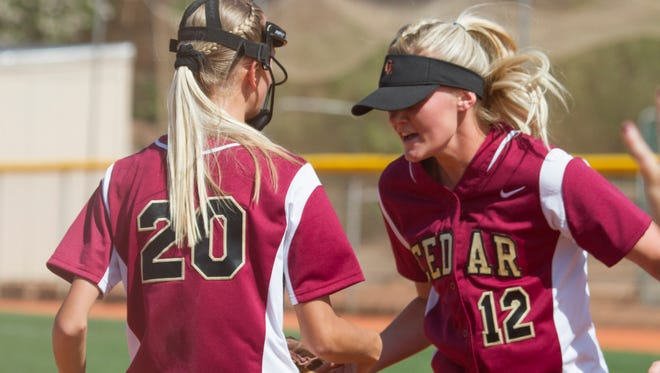Cedar's Bryton Holyoak (#12) celebrates after a win over Desert Hills to give the Redmen the Region 9 title. Holyoak and teammate Dream Weaver were recently named Co-MVP's on the All-Region 9 softball team which is voted on by the head coaches.