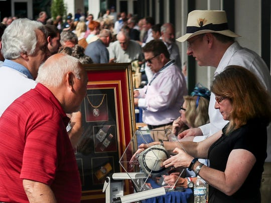 Hundreds of people hoping to have a valuable antique or artwork visited PBS' Antiques Roadshow event in the paddock of Churchill Downs in Kentucky on May 22, 2018.