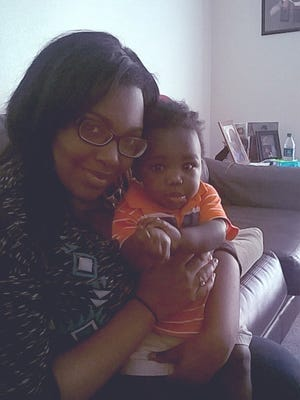 Jazmin, a teen mom, poses with her son. She was able to maintain a 4.0 GPA, membership in the hOnor Society and steady employment through school thanks to help from United Way partner agencies.