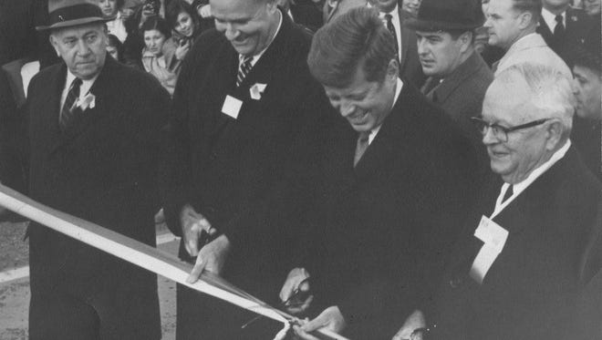 President John F. Kennedy cuts a ribbon at the dedication of the Delaware Turnpike on Nov. 14, 1963. With him is (from left) N. Maxon Terry of Dover, chairman of the old State Highway Commission, Delaware Gov. Elbert N. Carvel and Maryland Gov. Millard J. Tawes.