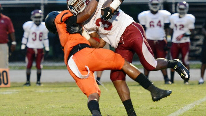 Cocoa's Taquan Pratt takes down Raines ballcarrier Rick Wells during Friday's game at Cocoa Stadium.