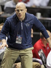 Penn State head wrestling coach Cael Sanderson, above, has announced that four-time Pennsylvania state champion Gavin Teasdale is transferring out of the Nittany Lions' program. FILE PHOTO