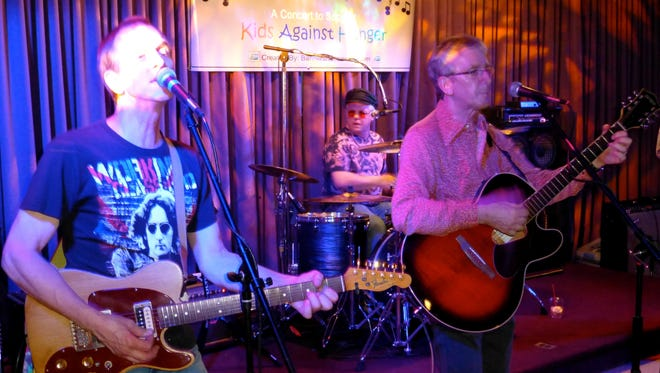 Tom Birchler, Tommy Anderson and Dave Birchler of The Paisley Fogg rock out at Jammin' to End Famine last year.