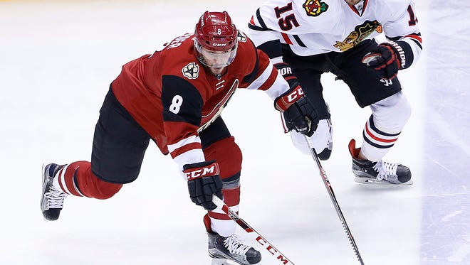 Coyotes' Tobias Rieder (8) skates away from Blackhawks' Artem Anisimov (15) in the first period at Gila River Arena in Glendale, AZ on February 4, 2016.