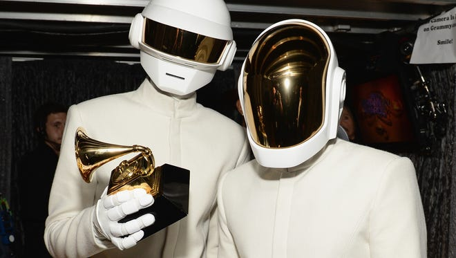 Thomas Bangalter and Guy-Manuel de Homem-Christo of Daft Punk pose with one of their Grammy trophies Sunday Night. The French pop duo won album and record of the year.