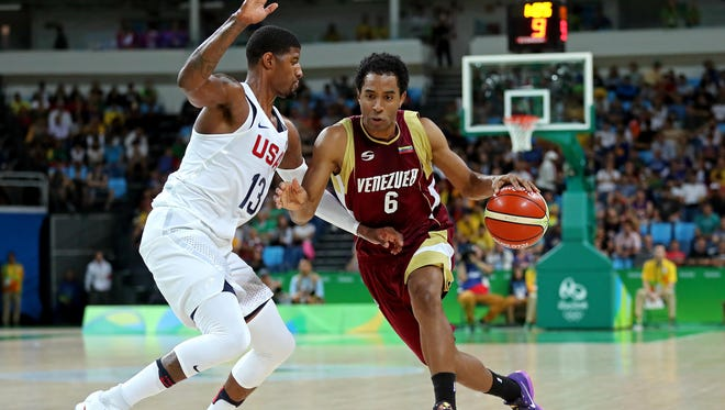 Venezuela forward Jhon Cox (6) drives to the basket against United States guard Paul George (13) during the men's basketball preliminary round in the Rio 2016 Summer Olympic Games at Carioca Arena 1.