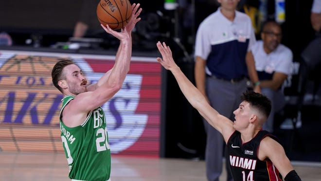 Celtics' Gordon Hayward takes a shot over the Heat's Tyler Herro during the second half of Saturday night's playoff game. Hayward, who had missed the last five weeks due to an ankle injury, played 30 minutes and had six points, five rebounds and four assists.