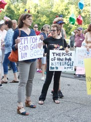 Demonstrators march through downtown Briarcliff Manor