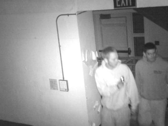 Police are seeking the identies of these two men who were caught on surveillance cameras inside Smith Middle School.