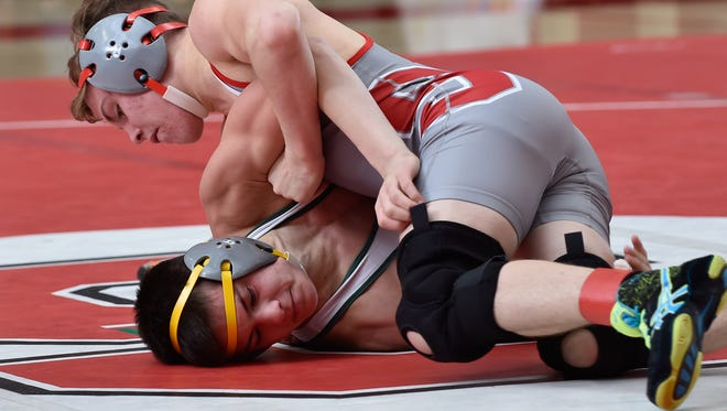 Smyrna's Cole Sebastianelli (top) controls Indian River's Jared Arlett on his way to the 126-pound title at the Eagle Classic last Saturday at Smyrna High,