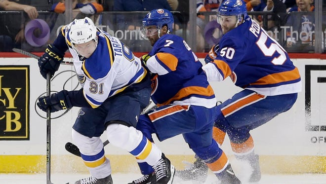 St. Louis Blues' Vladimir Tarasenko, left, scores a back hand goal during the second period of an NHL hockey game against the New York Islanders, Monday, Oct. 9, 2017, in New York. (AP Photo/Seth Wenig)