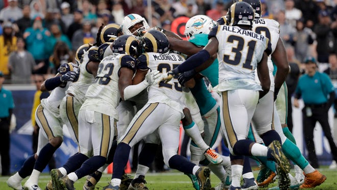 Miami Dolphins wide receiver Jarvis Landry scores against the Los Angeles Rams during the second half of Sunday's NFL football game. The Dolphins rallied late in the game to beat the Rams.