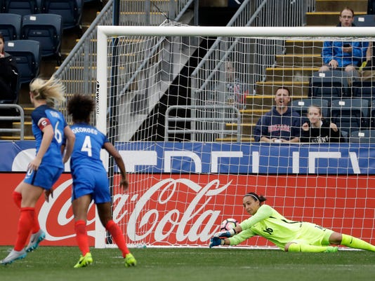 France's Sarah Bouhaddi (16) cannot stop a shot by England's Jordan Nobbs as Amandine Henry (6) and Laura Georges (4) look on during the first half of a SheBelives Cup women's soccer match, Wednesday, March 1, 2017, in Chester, Pa. (AP Photo/Matt Slocum)
