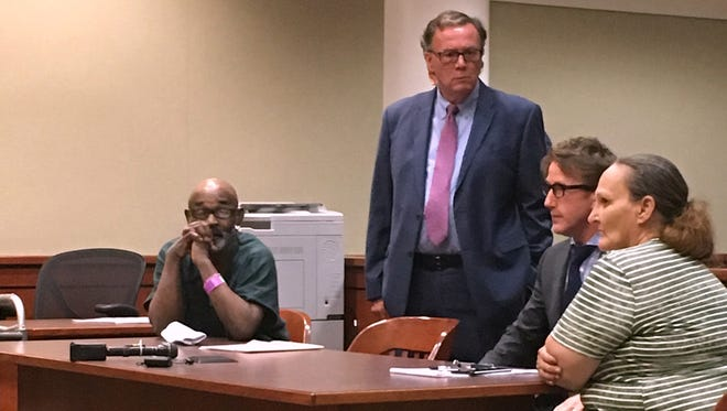 Quentin May (seated at far left), attorney Shawn Patrick Smith, unidentifed attorney and  Rebecca May (seated in green) at 23rd District Court in Taylor, Michigan on July 2, 2018.