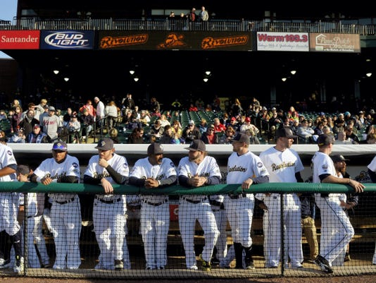 York Revolution players line up on the top step of the dugout on Friday as they prepare for their season opener against Long Island. The Revs and Ducks continue their three-game series today and Sunday at Santander Stadium.