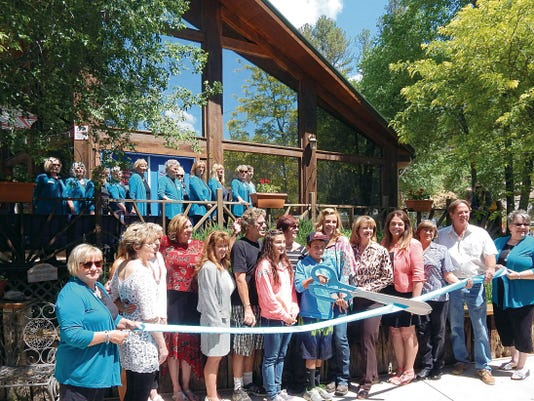 Ribbon cutting for added beauty options at the Sanctuary on the River.