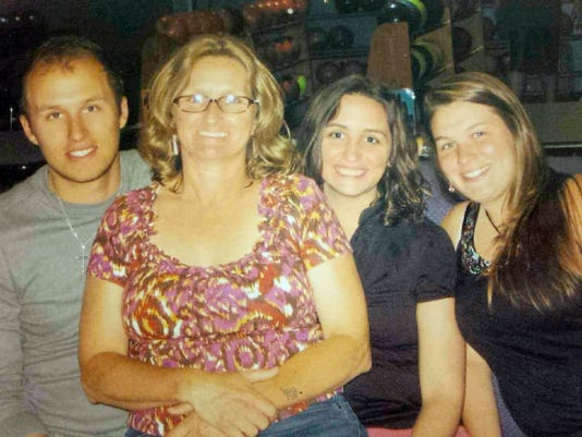 Barbara Schrum, second from the left, is pictured with her children, from the left, Matt Armold, Alecia Armold and Becky Schrum. On May 29, Barbara Schrum was murdered by Martin Kepner who also killed his estranged wife, Laurie Kuykendall, and then himself. Barbara Schrum's children say more needs to be done to help victims of domestic violence, and they have created a petition to get the Lethality Assessment Program in place at all police departments in Pennsylvania.