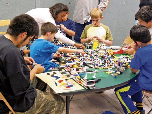 "Children enjoy the Lego Club at the Silver City Public Library on Wednesday. On June 3 the library will kick off the summer reading program with an appearance by ""The Magic Guy."" Randal Seyler - Sun-News"